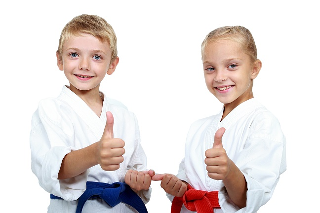 Boy and girl in karategi are showing thumb super