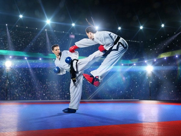 Two professional female karate fighters are fighting on the grand arena